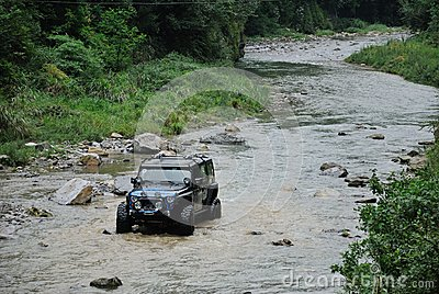 Jeep crossing the river