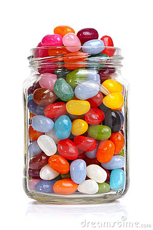 Jelly beans sugar candy snack in a jar isolated on white.