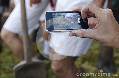 Jerez, Spain - September 10, 2013: Using mobile for news photo Editorial Stock Photo