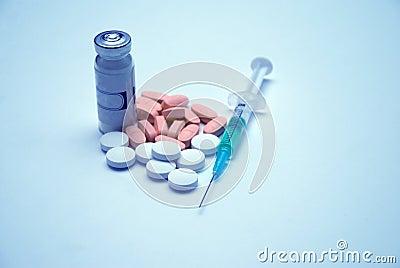 Jeringuilla, tabletas, medicinas