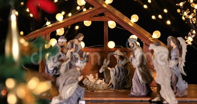 Jesus Christ Nativity scene with atmospheric lights near Christmas tree. Christmas scene. Dolly shot 4k stock footage