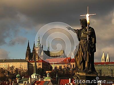 Jesus with cross against Prague Castle