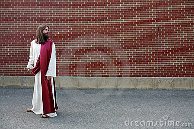 Jesus looking over his shoulder at blank wall