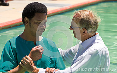 Evangelist Baptism african man Editorial Stock Photo