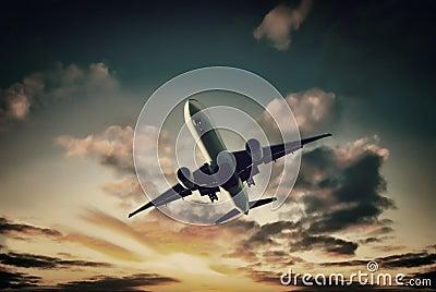 Jet Aeroplane Landing From Bright Sunset Sky