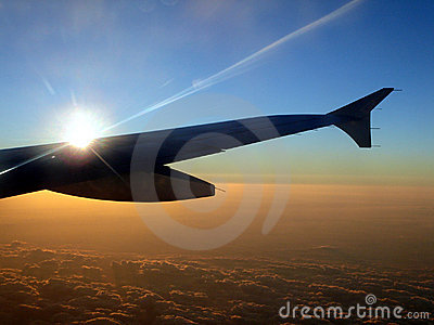 Jet Aircraft Wing at Sunset
