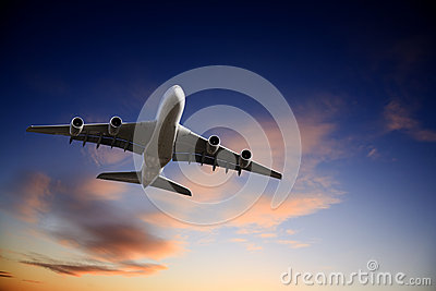 Jet Airplane Taking Off into Bright Twilight Sky