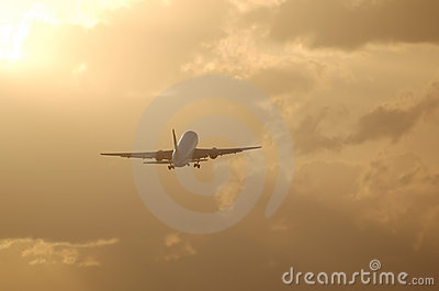 Jet liner taking off against sunrise