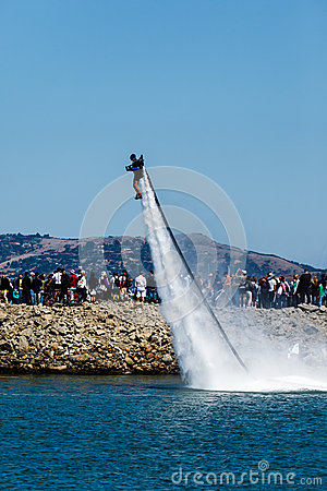 Jet propelled entertainer launches from the San Francisco Bay during celebrations for Louis Vuitton Cup in The Americas Cup Series Editorial Stock Image
