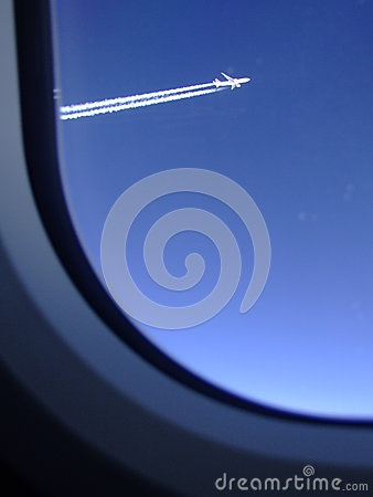 Free Jet Trails Of An Airliner Which Was Flying Alongside Seen Through The Window Of My Plane Royalty Free Stock Image - 53622496