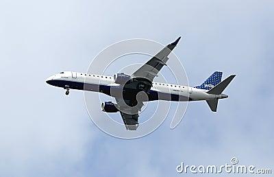 JetBlue Embraer 190 in New York sky before landing Editorial Image