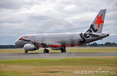 Jetstar A320 Lands at Christchurch Airport Editorial Stock Image