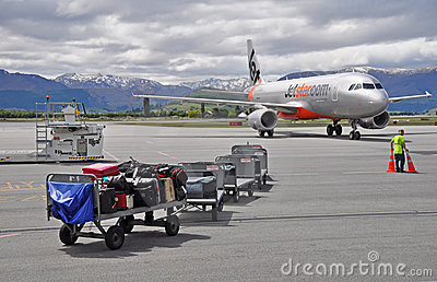 Jetstar Plane Taxies Into Queenstown Airport Editorial Stock Image