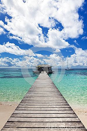 Free Jetty And Sail Boat At Tropical Beach Stock Images - 35179764
