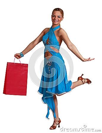Femme heureuse avec le sac à provisions