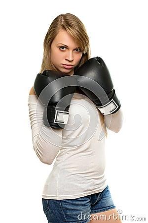 jeune femme posant avec des gants de boxe photographie. Black Bedroom Furniture Sets. Home Design Ideas