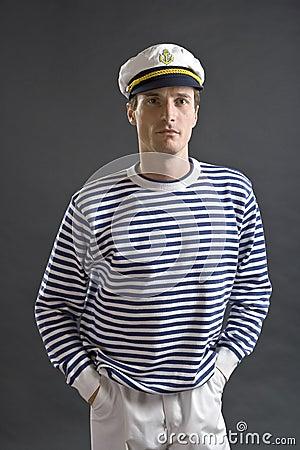 jeune homme de marin avec le chapeau blanc de marin image stock image 15310161. Black Bedroom Furniture Sets. Home Design Ideas