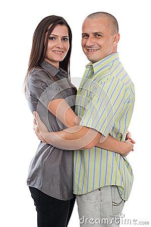 Jeunes couples attrayants d isolement sur le blanc
