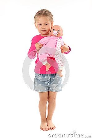 jeux de petite fille avec la poup e pr f r e photo stock image 43375774. Black Bedroom Furniture Sets. Home Design Ideas