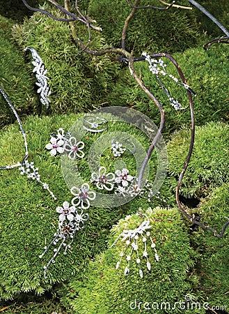Jewelery on green foliage