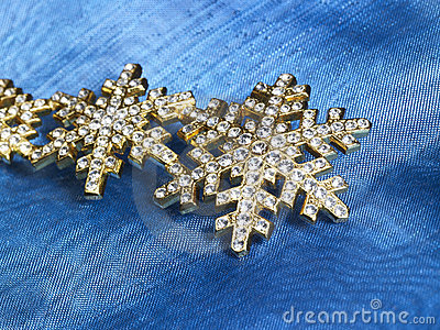 Jewellery in blue fabrics background