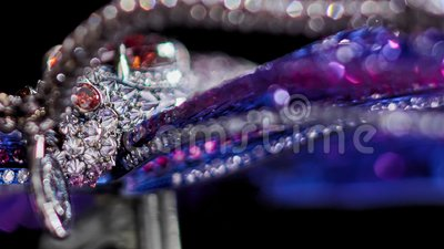 Jewelry with diamonds, extreme close up, not 3D, it`s video shooting only. Macro, natural rubies, sapphires, garnet, tilt shift lens bokeh stock video footage