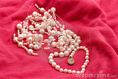 Jewelry made of pearls on the pink