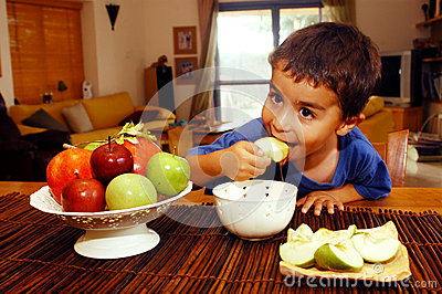 Jewish boy eats Apple in Honey Editorial Photo