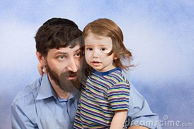 Jewish father in yarmulke with his young son