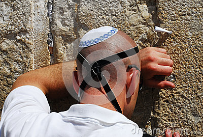 Jewish man pray at the Western wall in Jerusalem Editorial Image