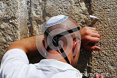 Jewish man pray at the Western wall in Jerusalem Editorial Image
