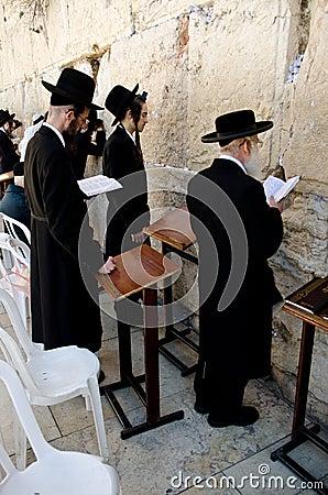 Jewish men praying at the Western wall Editorial Stock Image