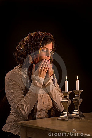 Jewish Woman Prays Over Sabbath Candles