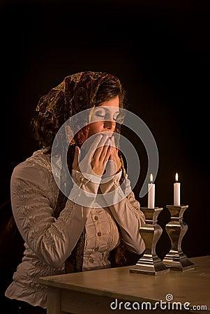 Jewish Woman Prays Over Sabbath Candles