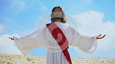 Jezus podnosi broń do nieba, niosąc błogosławieństwo i wiarę, religię chrześcijańską zbiory