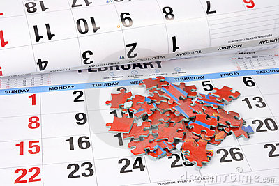 Jigsaw Puzzle Pieces on Calendar