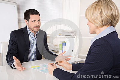 Job interview or meeting situation: business man and woman at de Stock Photo