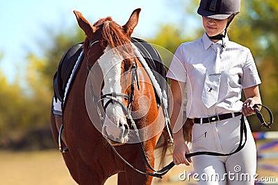 Jockey with purebred horse