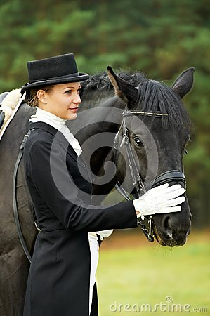 Jockey in uniform with horse