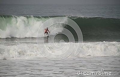 Joel Parkinson riding a wave Editorial Stock Image