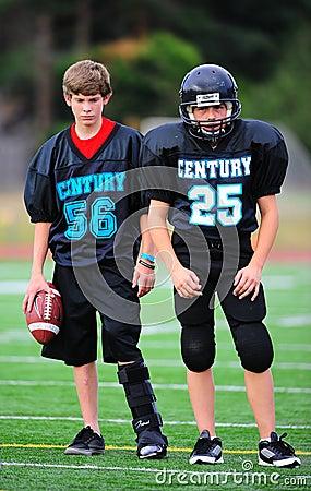 Jogador ferido do futebol americano da juventude Fotografia Editorial