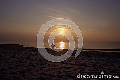 Jogger on beach