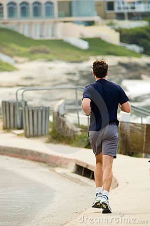 Jogger on boardwalk