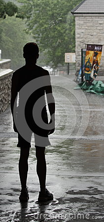 Jogger Waiting for the Rain to Stop Editorial Stock Image