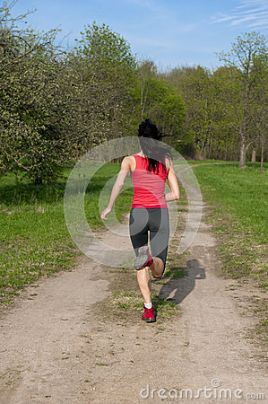 Jogging athletic woman in the park