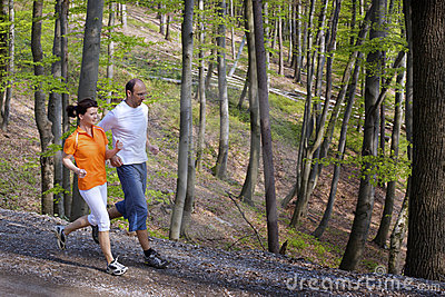 Jogging couple in forest