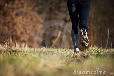 Jogging outdoors in a meadow
