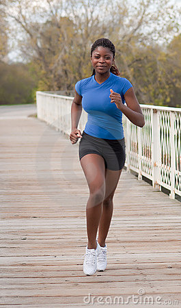 Jogging woman on bridge