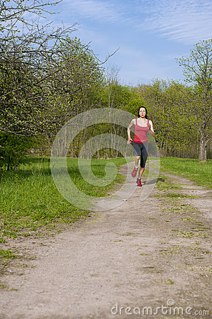 Jogging young athletic woman