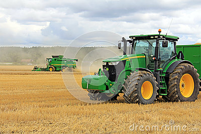 John Deere 7280R Agricultural Tractor and T560 Combine Harvester Editorial Photo